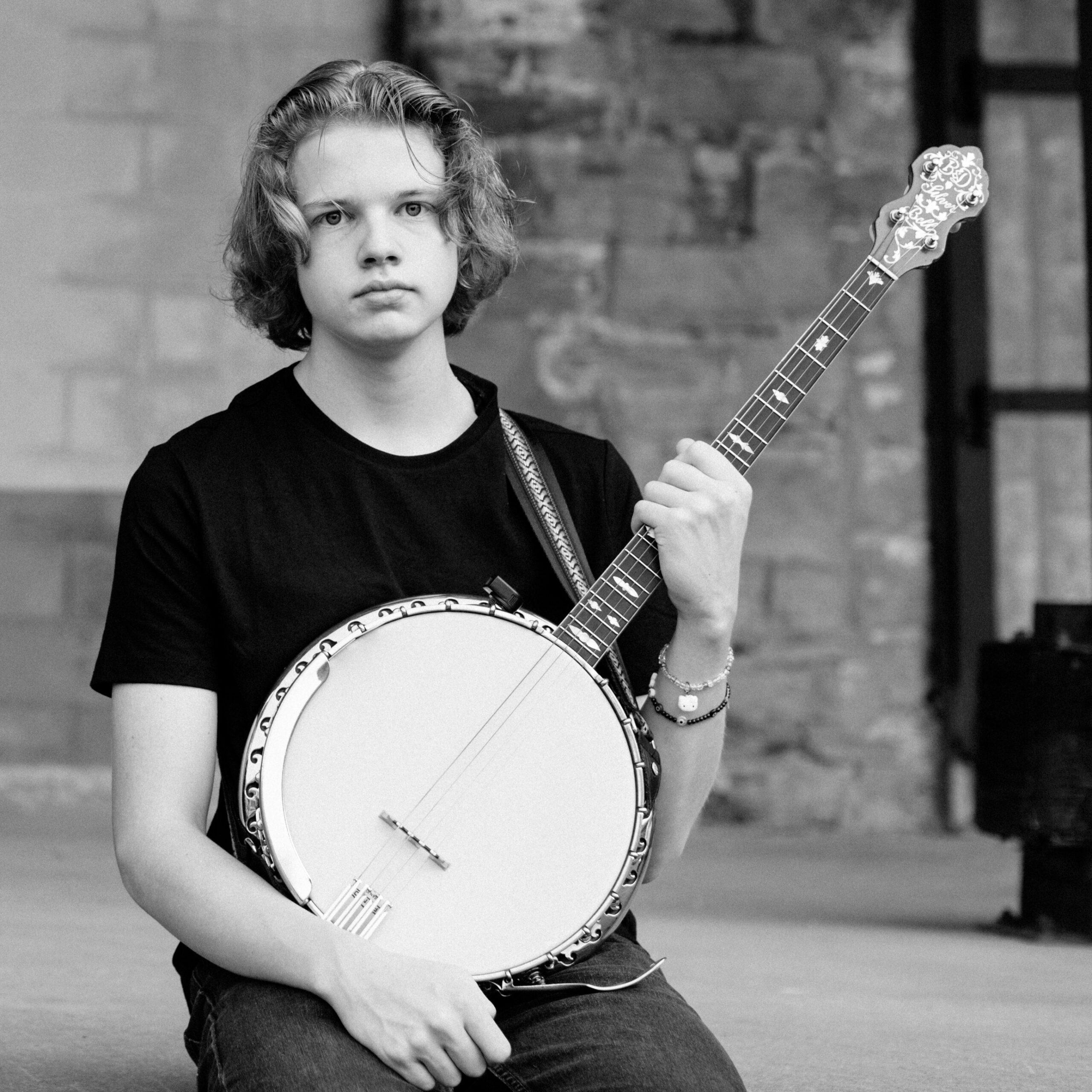 Promo shot of Morien McBurnie with banjo